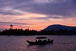 Boat and Sunset over Kampong Bay River, Kampot, Cambodia