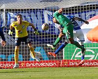 BOGOTA - COLOMBIA - 07 -03-2015: Deiver Machado (Der.) jugador de Millonarios disputa el balón con Ulises Tavares (Izq.) jugador de La Equidad, durante partido entre Millonarios y La Equidad por la fecha 8 de la Liga Aguila I-2015, jugado en el estadio Nemesio Camacho El Campin de la ciudad de Bogota. / Deiver Machado (R) player of Millonarios vies for the ball with Ulises Tavares (L) player of La Equidad, during a match between Millonarios and La Equidad for the  date 8 of the Liga Aguila I-2015 at the Nemesio Camacho El Campin Stadium in Bogota city, Photo: VizzorImage / Luis Ramirez / Staff.