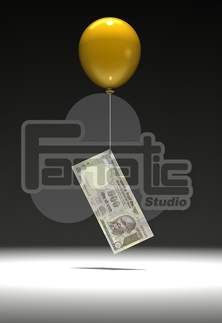 Indian five hundred Rupee note being lifted by balloon