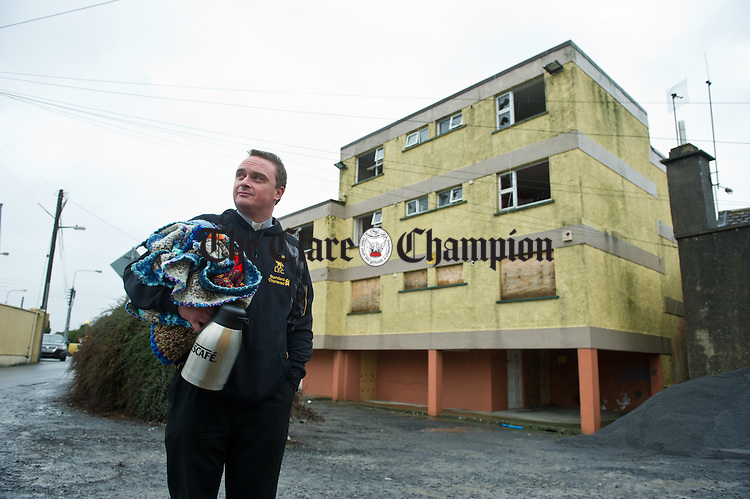 Fr Ger Fitzgerald of Ennis Parish, contemplates his forthcoming sleep-out on Christmas eve at the derelict Fairways flats in Ennis. Photograph by John Kelly.