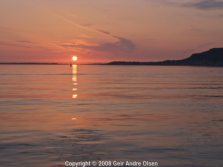 Beautiful sunset in the waters outside Aalesund, Norway