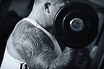 Pix: Shaun Flannery/shaunflanneryphotography.com...COPYRIGHT PICTURE>>SHAUN FLANNERY>01302-570814>>07778315553>>..26th January 2012…………….Health & Fitness bodybuilder..Bar bell curl.