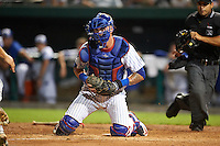 South Bend Cubs catcher Tyler Alamo (22) blocks the plate as umpire Ricardo Estrada gets in position during a game against the Burlington Bees on July 22, 2016 at Four Winds Field in South Bend, Indiana.  South Bend defeated Burlington 4-3.  (Mike Janes/Four Seam Images)