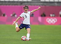 KASHIMA, JAPAN - AUGUST 2: Kelley O'Hara #5 of the United States kicks the ball during a game between Canada and USWNT at Kashima Soccer Stadium on August 2, 2021 in Kashima, Japan.