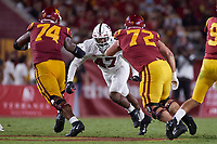 LOS ANGELES, CA - SEPTEMBER 11: Tangaloa Kaufusi #47 of the Stanford Cardinal attempts to get past Courtland Ford #74 and Andrew Vorhees #72 of the USC Trojans during a game between University of Southern California and Stanford Football at Los Angeles Memorial Coliseum on September 11, 2021 in Los Angeles, California.