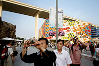 Men taking pictures at the Shanghai World Expo.