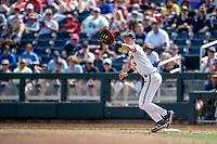 Michigan Wolverines first baseman Jimmy Kerr (15) makes a catch during Game 1 of the NCAA College World Series against the Texas Tech Red Raiders on June 15, 2019 at TD Ameritrade Park in Omaha, Nebraska. Michigan defeated Texas Tech 5-3. (Andrew Woolley/Four Seam Images)