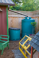 Small space sustainable back yard garden with chicken coop, rain barrel cistern, and compost bin