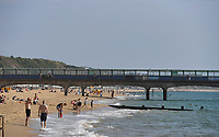 BNPS.co.uk (01202 558833)<br /> Pic: BNPS<br /> <br /> Pictured: Beach goers at Boscombe Pier<br /> <br /> Weather input - Warm weather in Bournemouth<br /> <br /> People made the most of the late September sun at Bournemouth beach in Dorset today (Sunday).