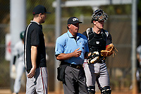 Omaha Mavericks head coach Evan Porter argues a call with the home plate umpire as catcher Brett Bonar (1) looks on during a game against the Dartmouth Big Green on February 23, 2020 at North Charlotte Regional Park in Port Charlotte, Florida.  Dartmouth defeated Omaha 8-1.  (Mike Janes/Four Seam Images)