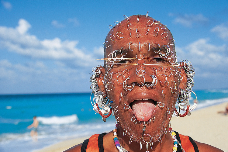Cuba: Playa del Este; The Earring Man: An extravagantly pierced Cuban beach character captured on Playa del Este, a popular public beach east of Havana.
