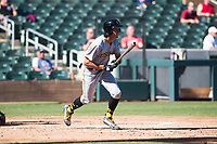 Surprise Saguaros shortstop Cole Tucker (2), of the Pittsburgh Pirates organization, starts down the first base line during an Arizona Fall League game against the Salt River Rafters at Salt River Fields at Talking Stick on November 5, 2018 in Scottsdale, Arizona. Salt River defeated Surprise 4-3 . (Zachary Lucy/Four Seam Images)