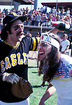 The Eagles 1978  Glenn Frey and Timothy B. Schmit celebrate at Eagles vs Rolling Stone Mag softball game.<br /> © Chris Walter