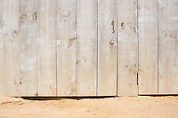 wooden door and a rocky and sandy beach