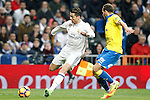 Real Madrid's Cristiano Ronaldo (l) and UD Las Palmas' Dani Castellano during La Liga match. March 1,2017. (ALTERPHOTOS/Acero)