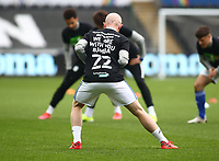20th March 2021; Liberty Stadium, Swansea, Glamorgan, Wales; English Football League Championship Football, Swansea City versus Cardiff City; Jonathan Williams of Cardiff City warms up wearing a shirt in support of team mate Sol Bamba of Cardiff City who was recently diagnosed with Non-Hodgkins Lymphoma