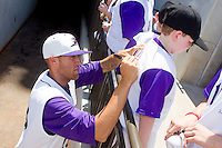 Brandon Kloess #28 of the Winston-Salem Dash signs autographs for young fans prior to the Carolina League game against the Wilmington Blue Rocks at BB&T Ballpark on April 24, 2011 in Winston-Salem, North Carolina.   Photo by Brian Westerholt / Four Seam Images