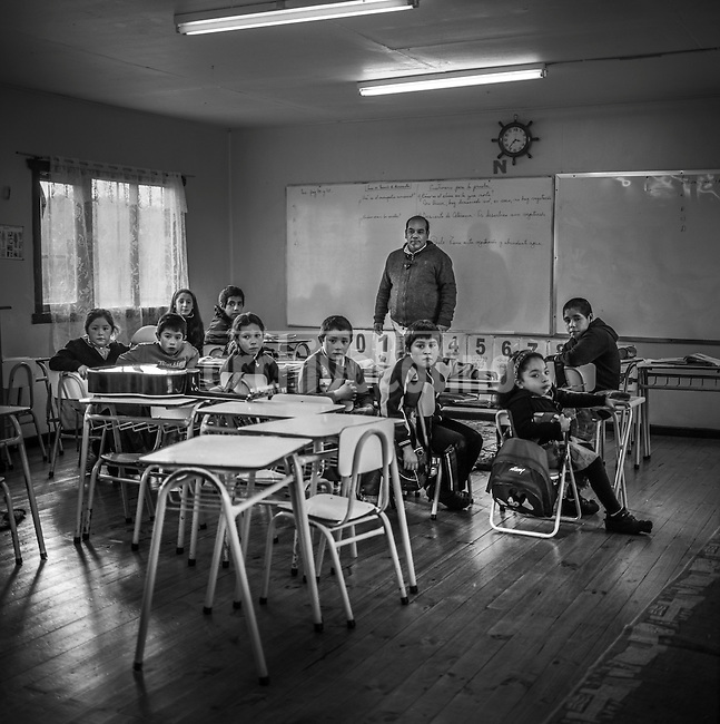 """De la serie """"Lo que aprendí de ti…"""" (herencia visual de dos generaciones) proyecto financiado por Fondart convocatoria 2013.<br /> Alumnos de la escuela de Surgidero junto al director y profesor en Isla Maillen, Región de Los Lagos, Puerto Montt, Chile<br /> Essay made by Sergio Candia and his son, Roberto, about a unknown and isolated island of Souther Chile: Maillen<br /> The name of  Maillen Island comes from  Huilliche Indians,  meaning """"young lady"""",  reminding a legend of a lady brought to the place by Dutch pirates who found a refugee in this remote and isolated  place.<br />  The island is located in the Southern region of  Chile , 45 minutes from Puerto Montt city by boat, the only link with the rest of the world.   The island , unknown for  most Chileans, has about 1,000 inhabitants  who make a a living basically from  agriculture, fisheries and some minor scale cattle breading.<br /> Dweller are mostly  elder people. Youngs preffer to look for some better luck elsewhere.<br /> Maillen has no doctors, no police either. The only authority is man designed as  Sea  Mayor."""