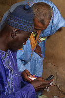 Cashew Nut Buyer Checking Calculations with his Assistant,  Fass Njaga Choi, The Gambia.