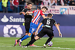 Yannick Ferreira Carrasco of Atletico de Madrid fights for the ball with Ruben Miguel Nunes Vezo and David Rodriguez Lomban of Granada CF during their La Liga match between Atletico de Madrid and Granada CF at the Vicente Calderon Stadium on 15 October 2016 in Madrid, Spain. Photo by Diego Gonzalez Souto / Power Sport Images