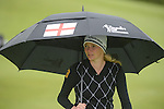 Englands Jodie Kidd takes cover as it starts to rain..Celebrity Cup at Golf Live  - Celtic Manor Resort - Friday 10th  May  2013 - Newport ..© www.sportingwales.com- PLEASE CREDIT IAN COOK
