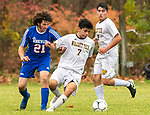 WOODBURY, CT-111120JS20 —Wolcott Tech's Brian Tacuri (7) tries to hold off Nonnewaug's Franco Pannofino (21) while trying to get control of the ball during their game Wednesday at Nonnewaug High School. <br /> Jim Shannon Republican-American