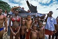Fishermen and children pose with Sailfish, Istiophorus platypterus, caught off beach, Salvador, Brazil, Atlantic Ocean