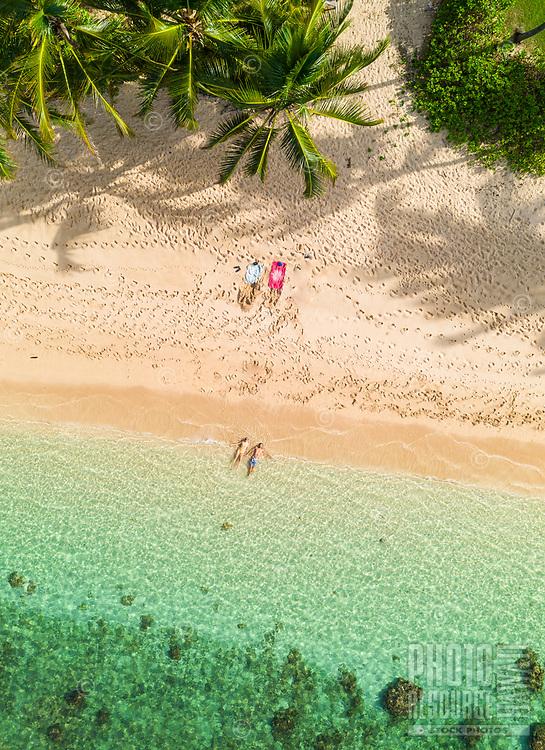 Aerial view of two swimmers enjoying the waters off of Mokule'ia Beach near Crozier Drive, Waialua, O'ahu.