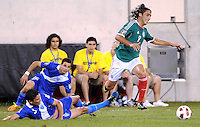 Mexico Aldo De Nigris (9) gets fouled by Guatemala Carlos Gallardo (5)  Mexico defeated Guatemala 2-1 in the quaterfinals for the 2011 CONCACAF Gold Cup , at the New Meadowlands Stadium, Saturday June 18, 2011.