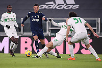 Cristiano Ronaldo of Juventus FC , Vlad Chiriches and Gian Marco Ferrari of US Sassuolo compete for the ball during the Serie A football match between Juventus FC and US Sassuolo Calcio at Allianz stadium in Torino (Italy), January 10th, 2021. Photo Federico Tardito / Insidefoto