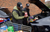 Adebayo Akinfenwa of Wycombe Wanderers - How the strongest man in football is spreading the Christmas cheer. <br /> <br /> Interview and feature will be shown on Sky Sports News HQ and across Sky Sports digital platforms Christmas Day.<br /> <br /> Bayo Akinfenwa (right) unloads food donations from his car with his brother Dele Akinz as he helps out at a Food Bank in Lewisham, England on 23 December 2016. <br /> <br /> Photo by Alan  Stanford / PRiME Media Images.