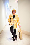 David Hockney lookalike at Liverpool Walker Art Gallery exhibition David Hockney: Early Reflections, posing in style of Lord Snowden's photograph of David Hockney wearing gold lamé jacket from Royal College of Art graduation.