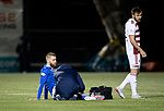 Hamilton Accies v St Johnstone …03.03.21   Fountain of Youth Stadium   SPFL<br />Shaun Rooney is treated by physio Mel Stewart before going off injured<br />Picture by Graeme Hart.<br />Copyright Perthshire Picture Agency<br />Tel: 01738 623350  Mobile: 07990 594431
