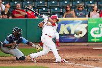 Kolten Wong (4) of the Springfield Cardinals follows through his swing during a game against the Northwest Arkansas Naturals at Hammons Field on June 14, 2012 in Springfield, Missouri. (David Welker/Four Seam Images)