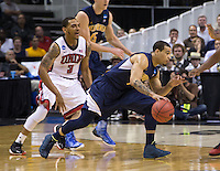 March 21st, 2013: California's Justin Cobbs dribbles away from UNLV's Anthony Marshall during a game at HP Pavilion, San Jose, California. California defeated UNLV 64 - 61