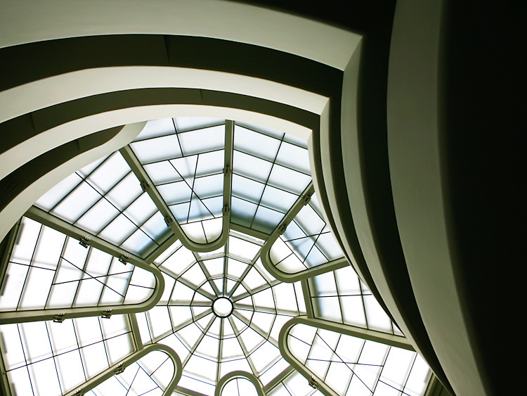 The Guggenheim Museum in New York City with its atrium skylight lit up during the day.