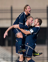 Julian Ringhof (33) of San Diego celebrates with teammates Patrick Wallen (10) and Thomas Fiskerstrand (4) during the game at North Kehoe Field in Washington, DC.  Georgetown defeated San Diego, 3-1.