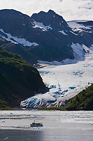 MV Discovery in front of Tigertail Glacier, Nassau fjord, Prince William Sound, Alaska.