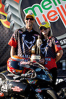 Sep 29, 2013; Madison, IL, USA; NHRA pro stock motorcycle rider Matt Smith (left) celebrates with wife Angie Smith after winning the Midwest Nationals at Gateway Motorsports Park. Mandatory Credit: Mark J. Rebilas-