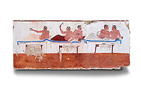 "Greek Fresco on the inside of Tomb of  the Diver  [La Tomba del Truffatore]. This panel is from one of the long sides of the tomb and shows a symposium of men lying on couches facing low tables on which goblets have been placed.  The abondon experienced at the Synposium was one way in which the dead could access the next world . The tomb is painted with the true fresco technique and its importance lies in being ""the only example of Greek painting with figured scenes dating from the Orientalizing, Archaic, or Classical periods to survive in its entirety. Paestrum, Andriuolo.  (480-470 BC  )"