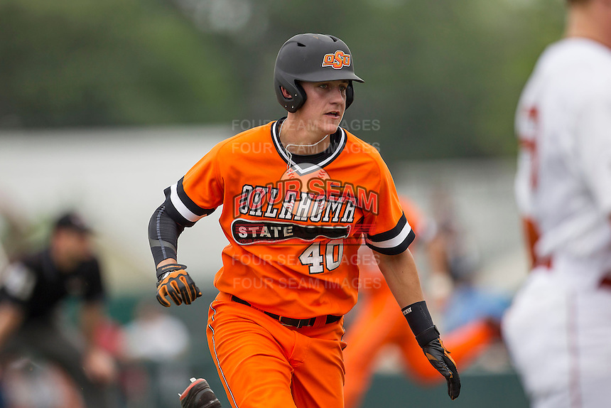 Oklahoma State Cowboys third baseman Craig McConaughy #40 runs to third base during the NCAA baseball game against the Texas Longhorns on April 26, 2014 at UFCU Disch–Falk Field in Austin, Texas. The Cowboys defeated the Longhorns 2-1. (Andrew Woolley/Four Seam Images)