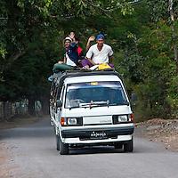 Myanmar, Burma.  Young Burmese Men, Oblivious to Good Safety Rules.
