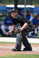 Umpire Chris Marco in position to make a call during a game between the GCL Yankees 2 and GCL Blue Jays on July 2, 2014 at the Bobby Mattick Complex in Dunedin, Florida.  GCL Yankees 2 defeated GCL Blue Jays 9-6.  (Mike Janes/Four Seam Images)