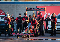 Oct 31, 2020; Las Vegas, Nevada, USA; Crew members surround the dragster of NHRA top fuel driver Steve Torrence during qualifying for the NHRA Finals at The Strip at Las Vegas Motor Speedway. Mandatory Credit: Mark J. Rebilas-USA TODAY Sports