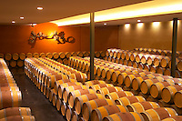 The barrel aging cellar with a sculpture on the far end wall symbolising the flight of a dove Chateau Paloumey Haut-Medoc Ludon Medoc Bordeaux Gironde Aquitaine France