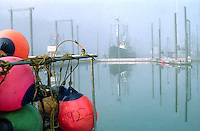 Buoys and a fishing boat on a foggy day in Dog Bay Harbor, Kodiak, Alaska