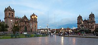 Peru, Cusco.  Plaza de Arman.  Cathedral on the left, Church of La Compania on the right.  Early Evening.
