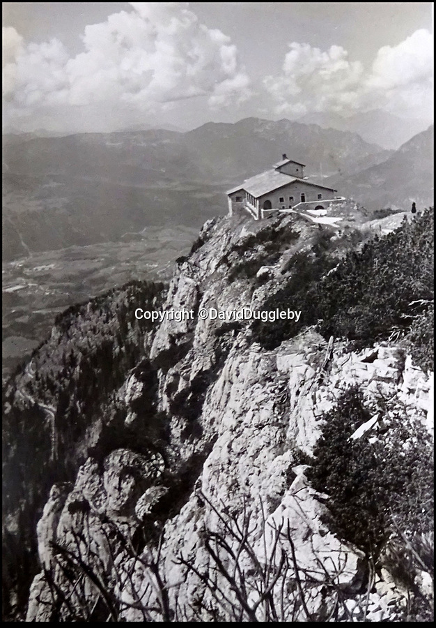 BNPS.co.uk (01202 558833)<br /> Pic: DavidDuggleby/BNPS<br /> <br /> The Eagles Nest - where the Fuhrer did all his blue sky thinking - It was built at vast cost by the Nazi's to give to him as a present in 1939.<br /> <br /> This amazing photo album reveals the close knit alpine community where Hitler and his henchmen worked and played.<br /> <br /> The album was brought back to Britain by a British administrator of the railways in post war Germany and reveals the cosy living arrangements of the high ranking Nazi's of Hitlers Third Reich.<br /> <br /> It shows the homes of Hitler, Martin Boorman and Hermann Goering in tiny Berchtesgaden in Bavaria, and also the infamous Eagles Nest on a mountain top nearby where the evil dictator would dream his dreams whilst taking in the stunning vista.<br /> <br /> The unique album is being sold by David Duggleby auctioneers in Scarborough on the 7th October.