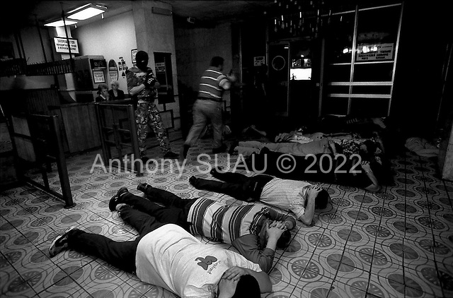 Moscow, Russia .1995.ROUP, the department Against Organized Crime in Moscow, busts a pool hall to break a rasbourka in process. Eveyone is immeddiately forced to the floor by ROUP. Guns are found and arrests made.