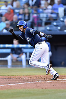 Asheville Tourists catcher Joel Diaz (5) runs to first base during a game against the Kannapolis Intimidators at McCormick Field on April 18, 2017 in Asheville, North Carolina. The Intimidators defeated the Tourists 2-1. (Tony Farlow/Four Seam Images)